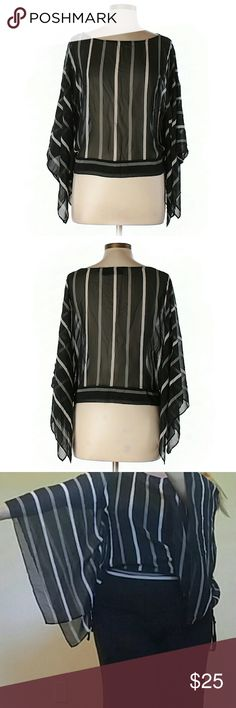 "NY & Company Flutter Dolman Sleeve Striped Top This sultry top will turn heads! Classic grey & white stripes over a black background. 3/4 length wide butterfly sleeves are so dramatic! Lightweight, sheer fabric (I wear a black cami). Banded cinched waist hits at hips & creates a blouson fit. Scoop neck. Gently loved. No real signs of wear.   {Measurements} Chest: 40"" Length: 17"" Hips/Waistband: 18""  {Materials} 100% Polyester New York & Company Tops"