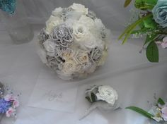 Ivory and silver grey roses crystals brooch Bridal Bouquet  £125.00  . Button hole £5.00
