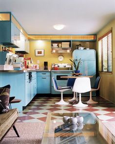 How adorable is this Mid Century Modern Kitchen? The colors are so fun.
