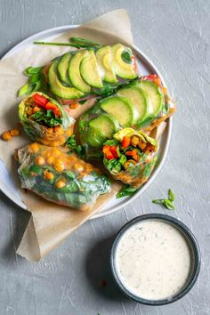 These buffalo chickpea rice paper wraps with tahini ranch dip are full of avocado, collard greens, red bell pepper, & fresh herbs for the perfect light meal Rice Paper Wraps, Rice Wraps, Vegan Rice Paper Rolls, Chickpea Recipes, Vegetarian Recipes, Healthy Recipes, Vegetarian Sandwiches, Going Vegetarian, Vegetarian Cooking