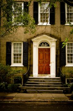 Wood front doors with classic arched window above. Black shutters and white trim. Exterior Design, Interior And Exterior, Future House, My House, Town House, Porches, Black Shutters, Windows And Doors, Curb Appeal