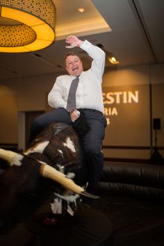 Guests had a great time riding the mechanical bull at an event held at the Westin Galleria. Mechanical Bull