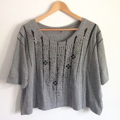 "UO Gray Oversized Studded Tee Super cozy and cute! Large, off the shoulder, semi-cropped style. Perfect paired with black skinnies and ankle booties! Purchased from Urban Outfitters, Sparkle & Fade brand. Size small, measures 27"" wide, 21"" long. 50% polyester, 38% cotton, 12% rayon. Great condition! Urban Outfitters Tops Tees - Short Sleeve"
