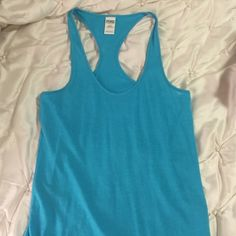 PINK Turquoise Tank Top PINK by Victoria's Secret Turquoise tank top. New, never worn. Tags not attached. Size small. PINK Victoria's Secret Tops Tank Tops