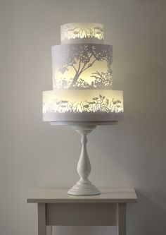 The glowing tiers of this wedding cake appear to be lit from within. Very clever painting by Rosalind Miller. Seriously awesome