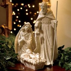 Holy Family Nativity Set dusted with iridescent flecks for enchanting sparkle.  This is the true spirit of Christmas