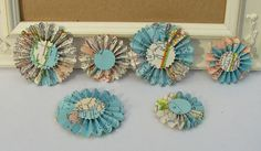 Hey, I found this really awesome Etsy listing at http://www.etsy.com/listing/117972862/upcycled-map-paper-rosettes-set-of-6