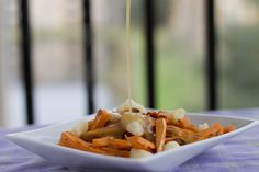 Oh. hell. yes. Sweet Potato Poutine with Sweet Potato Fries | Yum and Yummer