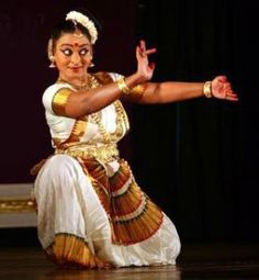 """Mohiniattam is a dance form which is said to be originated in Kerala, is well-known as the dance of the celestial enchantress. It is one of the most famous classical dances of Kerala. The term Mohiniyattam comes from the words """"Mohini"""" meaning a woman who enchants onlookers and """"aattam"""" meaning graceful and sensuous body movements. Mohiniattam is performed only by women and is known for its elegant actions and easy but stylish costume."""
