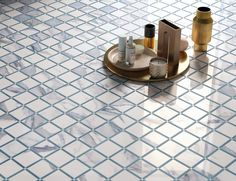 Achieve the luxurious look of marble with our durable Milan Timeless Matte Mosaic Porcelain Tile in Atlantic Blue. With the same classic unique veining of real marble, this tile is just the thing you need to complete your next home renovation! It starts at $34.99 SH.