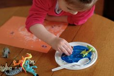 Using Plastic Animals to create Footprint Art- A fun, fine motor skills activity for all ages!
