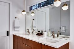 Split Level Remodel – Sammamish Split by Board & Vellum – White bathroom with wood vanity. Long Narrow Bathroom, Small Bathroom Window, Master Suite Bathroom, Bathroom Windows, Vanity Bathroom, White Bathroom, Bathroom Ideas, Bi Level Homes, Split Level Remodel