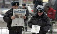 Russian police officers read newspapers on the streets of central Moscow,  2007.