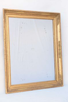 Napoleon Period Giltwood Mirror | From a unique collection of antique and modern wall mirrors at https://www.1stdibs.com/furniture/mirrors/wall-mirrors/