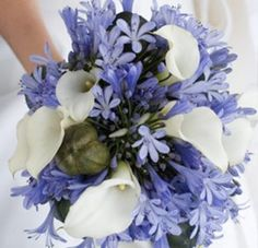 Like this if it were more blue and less purple, and maybe different kinds of flowers too, but I like the calla lillies