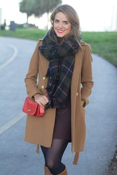 Camel Day coat, large plaid scarf, dark dress with boots.