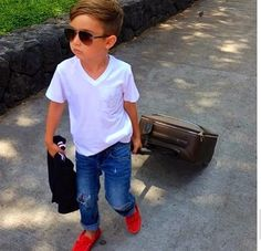 Cute little boy style.. time to get him some v-necks like his dad.