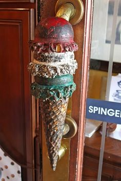 What a delicious way to enter! It simply must be an ice cream shop - or a dental office with a twisted sense of humor! Door handle in Charleston SC Door Knobs And Knockers, Knobs And Handles, Door Handles, Door Knockers Unique, Wooden Handles, Cool Doors, Unique Doors, Door Detail, Door Furniture