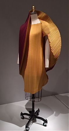 I have seen clothing by Issey Miyake in person and they are as spectacular as they look in the photo. This particular outfit is at the Metropolitan Museum of Art exhibition Manus X Machina.Issey Miyake, 1990  Machine-garment-pleated, machine-sewn yellow and red-purple polyester-linen plain weave.