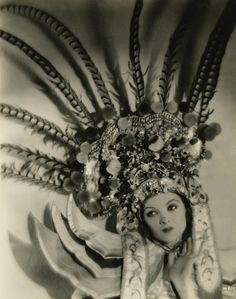 Myrna Loy in Magnificently Designed Feather and Gold Head-dress!