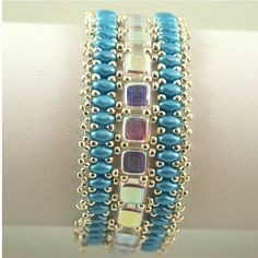 Czechmate and Super Duo bracelet in Aqua by ChainedByLightness
