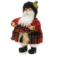 """Scottish Kilted Santa    This roly-poly Santa is truly dashing in his red plaid outfits and will add such fun to your Christmas decor. It is 8"""" tall, resin and fabric."""