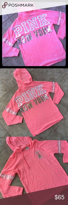 ✨PINK✨ New York City Exclusive Top PINK by Victoria's Secret oversized hooded top.  Sold only in NYC locations.  Small Pink New York City logo with Statue of Liberty on front left.  Both sleeves have New York printed band around upper arm.  Large PINK NEW YORK written across back.  Lightweight material.  Oversized top that looks great with leggings.  Only worn one time - excellent condition. PINK Victoria's Secret Tops Sweatshirts & Hoodies