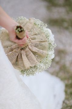 This uses burlap, but I also thought it might be pretty to do this with matching fabric from the dress or veil.