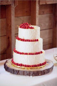 raspberry garnished wedding cake #weddingcake #raspberrycake #weddingchicks http://www.weddingchicks.com/2014/03/04/take-your-time-wedding/