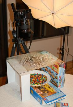 The camera was a Canon Rebel XTi with a 100mm f/2.8 macro lens attached. He used a single Alienbee B800 for lighting along with a shoot-through umbrella. Here's his secret on how he gets the water drops to collect into beads:       I used RainX to make the water bead up and to create the drops I use a spray bottle set to very fine mist and let the drops slowly get bigger with each spray until I reached the drops were the size I wanted.