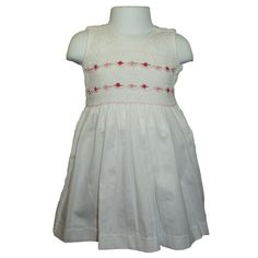 """Freya (White) - Traditional smocked dress with embroidery overlay.  Sleeveless style.  Button fastening of the straps and back, with matching fabric """"ribbons"""" to tie a bow. Available in sizes 1-8 years."""