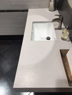 Quartz slabs are a go-to for many homeowners, as it is low-maintenance and a statement piece when installed in kitchens, bathrooms, and more. Bathroom Countertops, Quartz Countertops, Quartz Slab, Bath Mat, Kitchens, Sink, Commercial, Ivory, Waves