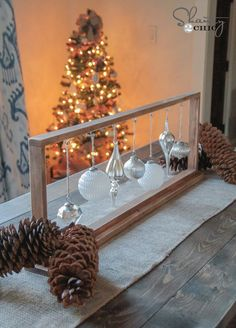 Put out memorable Christmas table decorations this season with these holiday decor ideas. From stunning Christmas centerpieces to place settings and beyond, our table decorations are sure to sparkle. Noel Christmas, Christmas Projects, All Things Christmas, Christmas Bulbs, Xmas, Homemade Christmas, Diy Christmas Frames, Christmas Shadow Boxes, Purple Christmas
