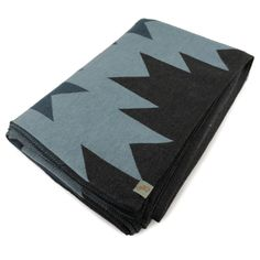 A bold graphic pattern on a high quality merino wool blanket.