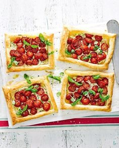 Nestled in the heart of these flakey puff pastry tarts is a moreish combination of salty parmesan, aromatic herbs and succulent, sun-kissed tomatoes. Serve them at your next summertime dinner party and you're bound to impress Souffle Recipes, Tart Recipes, Free Recipes, Vegetarian Starters, Vegetarian Recipes, Vegan Recepies, Beetroot Carpaccio, Dinner Party Recipes, Brunch Party