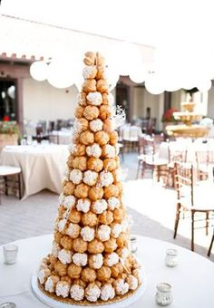 or perhaps a french croquembouche wedding cake? (a tier of cream puffs and spun sugar)