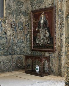 The portrait of Queen Elizabeth I hanging on top of one of the Gideon tapestries in the Long Gallery. ©National Trust Images/Andreas von Einsiedel