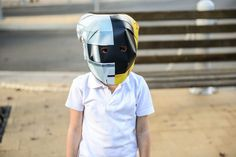 GLOBAL REACH: A child wearing a Daft Punk helmet posed for a photographer as locals prepared for the global launch party of the French band's new album, Random Access Memories, in Wee Waa, Australia, Thursday. (Shanna Whan/European Pressphoto Agency)