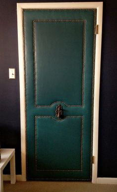 To do: upholster door using a vinyl tablecloth, staple gun, and nail head trim.