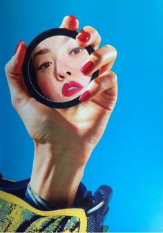 love the idea of holding something, not a mirror though because we're not showing off other kinds of makeup like lips or eyes, just the nails
