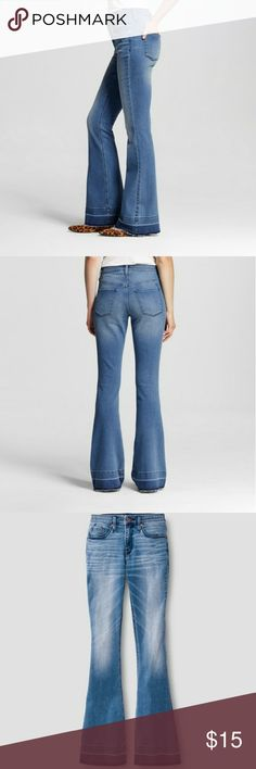 """Mossimo high rise flare jeans, super stretch Pre owned. Super Stretch fabric moves with you, so comfortable. Slim fit through hip, thigh and knee. Trendy, casual released hem. Flattering high-rise waist. In good used condition, no flaws, worn a handful of times.  Rise: 10"""" Inseam: Regular - 34"""" Waist across: 14"""" Flare leg opening: 22"""" Jeans Flare & Wide Leg"""