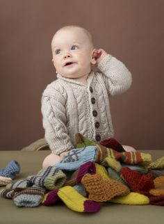 Heirloom Cables Baby Sweater free pattern by Lion Brand - just knitted this sweater for a wonderful friend's baby without the buttons and the buttonholes.