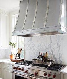 zinc-french-kitchen-hood-marble-slab-stove-backsplash