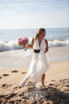 Barefoot Bride on the Ocean City, MD beach with bridal flower bouquet after ceremony by Rox Beach Weddings:  http://roxbeach.com/