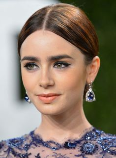 So pretty Lilly Collins is, pretty with pretty slick hair.