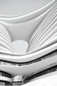 Galaxy Soho by Zaha Hadid. I would probably describe much of her work to be deconstructivist, its forms do not make sense.