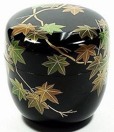 Japanese lacquered tea box or caddy (Usucha-ki or natsume) for holding the powdered tea used in tea ceremony, gold  and green maple leaves design on black, lacquered wood, 20th century, Japan