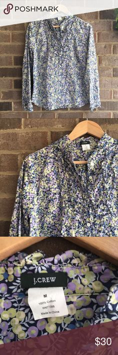 J. Crew Floral Ruffle Patterned Blouse Made from cotton, this long sleeve top by J. Crew is great for dressing up an outfit. The pattern really makes the piece. In great condition. Approximate measurements lying flat:  20' bust, 25.5' length 10816 J. Crew Tops Button Down Shirts