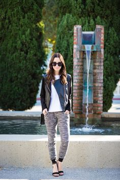 Dress up a pair of sweats with a leather jacket and heels.