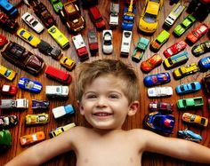 Little boy and his cars...except my little guy would need to be surounded by tractors and toy cattle